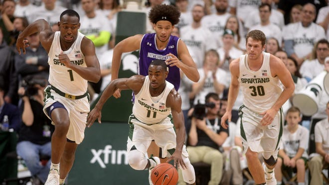 Junior guard Tum Tum Nairn Jr. runs the ball down the court during the game against Northwestern on Friday, Dec. 30, 2016 at Breslin Center.