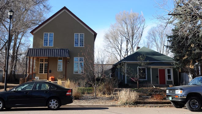 The house at on Whitcomb Street looms over its neighbor in Fort Collins.