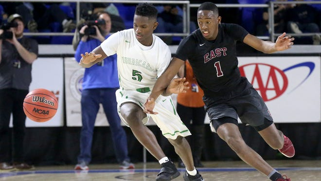 East Hamilton's Sam Randolph (5) and Memphis East's Terrance Moss (1) both go after a loose ball during the quarterfinal round of the Class AAA State Tournament on Wednesday, March 15, 2017.