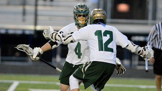 York Catholic's Kyle Dormer, left, and Chandler Hake are seen here in a file photo celebrating a goal. Dormer has been a key performer on the Fighting Irish defense. Hake had a hat trick in Thursday's win over Red Lion. YORK DISPATCH FILE PHOTO