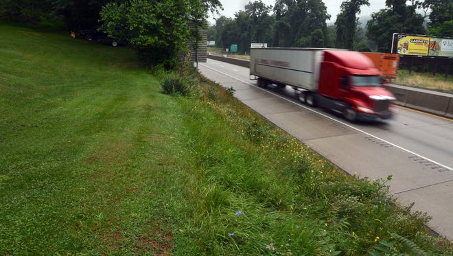 No fence separates Lynn Baker's yard from Interstate 83 in Fairview Township. Baker's grandson, Bryce Treichler, 6, was killed Tuesday when he rode his minibike onto the interstate and was struck by a car. Thursday, July 6, 2017. John A. Pavoncello photo