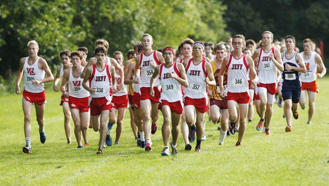 Runners from Lafayette Jefferson are bunched at the front early in the boys race of the City/County cross country meet Tuesday, September 2, 2014, at the Tippecanoe Amphitheatre.
