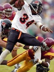 Steven Jackson ran for 1,690 yards in 2002, a single-season school record.