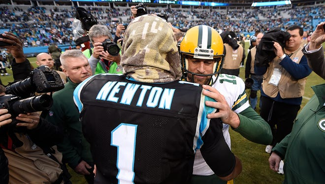 Green Bay Packers quarterback Aaron Rodgers and  Carolina Panthers quarterback Cam Newton meet after Sunday's game at Bank of America Stadium in Charlotte, NC. The Panthers defeated the Packers 37-29.