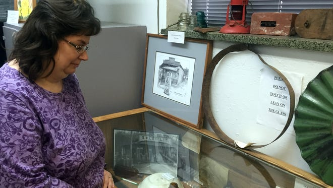 Melissa Barker, Houston County Archivist, checks out some historical documents in the archives. Barker teaches genealogy classes every fourth Tuesday of the month for free at the Houston County Public Library.
