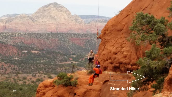 A picture of the rescue team airlifting the stranded hiker.