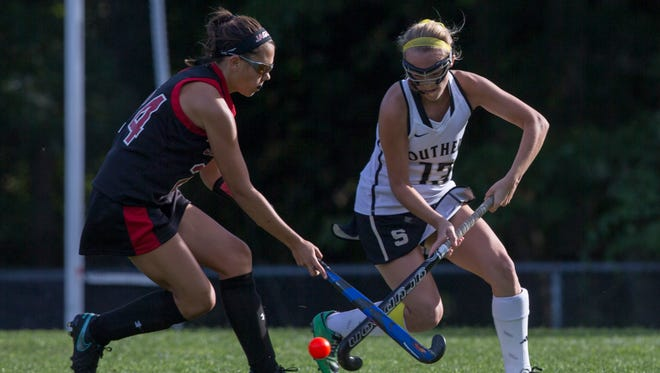 Jackson Memorial's Chloe Daum and Southern's Lauryn Flynn battle for ball control during Southern Regional Field Hockey vs Jackson Memorial on September 15, 2016 in Stafford, NJ.