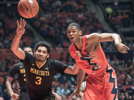 Minnesota forward Jordan Murphy (3) and Illinois guard Malcolm Hill chase a loose ball in the first half of an NCAA college basketball game at the State Farm Center in Champaign, Ill., on Sunday, Feb. 28, 2016. (AP Photo/Rick Danzl)