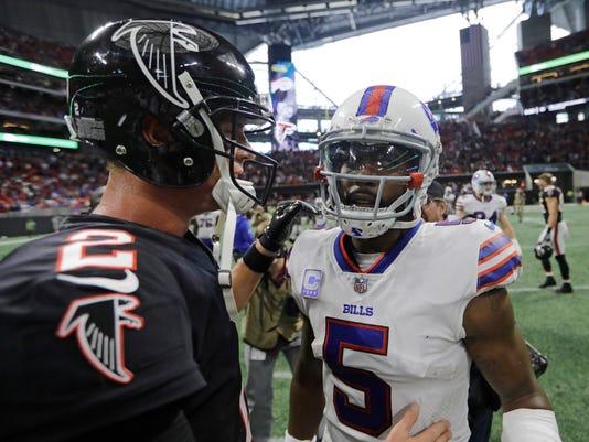 Atlanta Falcons quarterback Matt Ryan speaks with Buffalo Bills quarterback Tyrod Taylor after an NFL football game, Sunday, Oct. 1, 2017, in Atlanta. The Buffalo Bills won 23-17. (AP Photo/David Goldman)