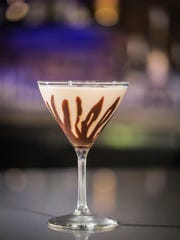 The Jungle's new barroom drinks list offers nearly two dozen cocktails: traditional, coffee and specialty. Here, java from local Magpie Coffee Roasters anchors a Jungle martini.