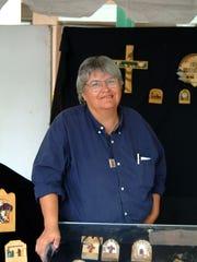 Tomasita Rodriguez of Las Cruces creates painted bultos and retablos.