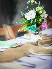 Lace and burlap transform a Mason jar into a centerpiece