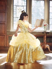 The Ultimate Collection Disney Princess Belle costume features gold brocade blooms, rhinestone accents and a tulle underskirt with hoops. $150 at chasing-fireflies.com.