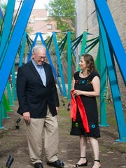 Sheboygan Mayor Mike Vandersteen chats with artist Diana Gabriel at the grand opening of her immersive art experience in downtown Sheboygan on June 21.