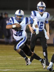 Zanesville's Leo Crosby looks for running room during