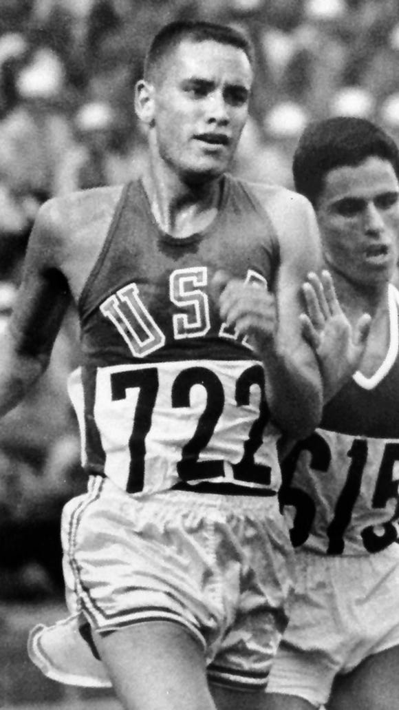 Billy Mills (722) goes on to win the 10,000-meter run