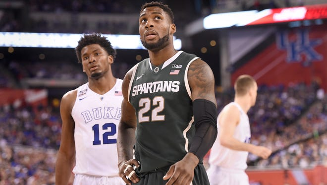 MSU's  Branden Dawson looks up as the clock winds down as MSU  loses to Duke 81-61 in the Final Four in Indianapolis Friday  4/3/2015.