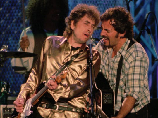 Bob Dylan and Bruce Springsteen perform during 1995 Rock and Roll Hall of Fame festivities in Cleveland.