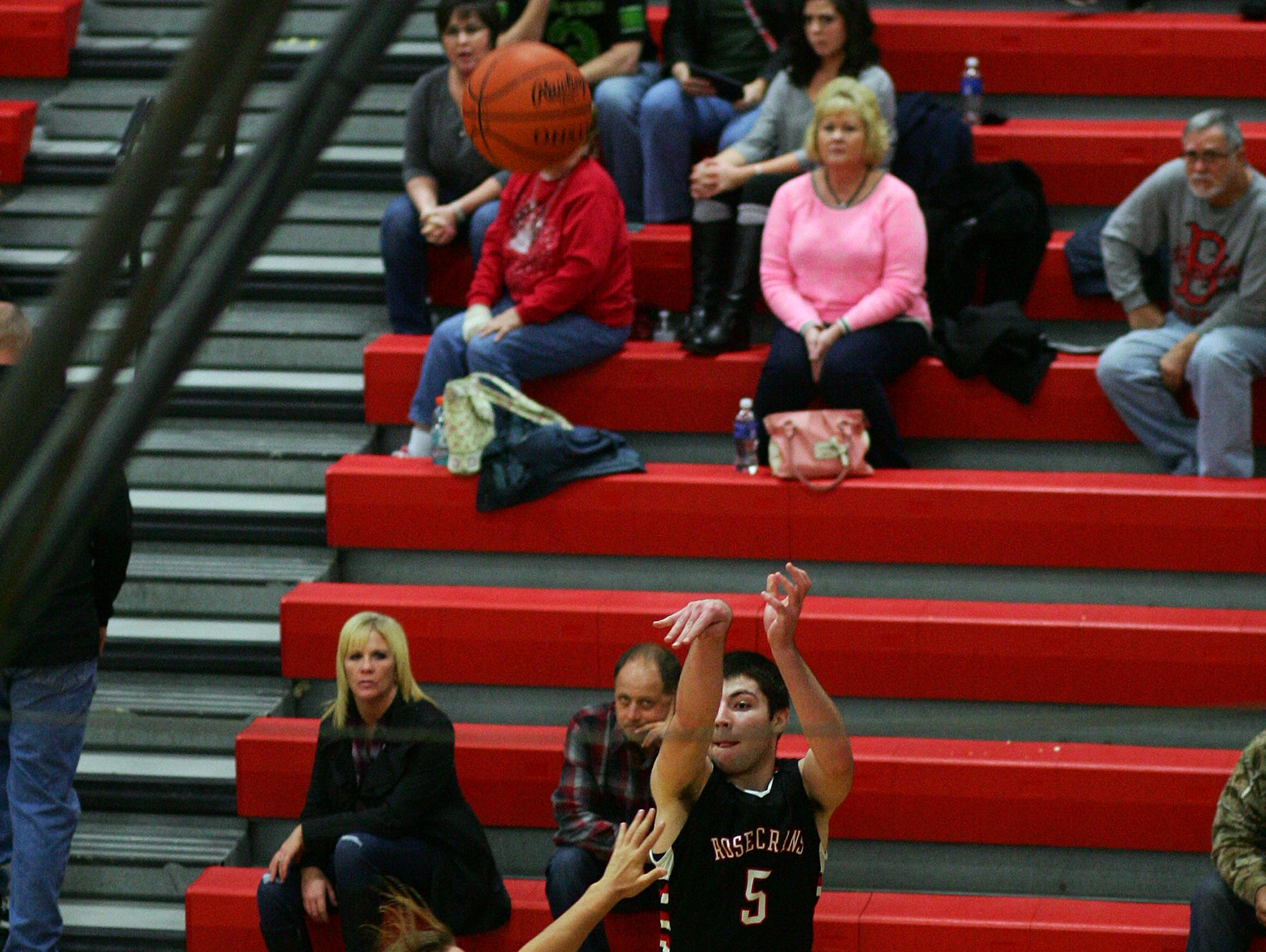 Bishop Rosecrans junior Michael Fisher shoots for three Friday during the teams' 69-68 victory over Coshocton in overtime. Fisher made 10 three point baskets.