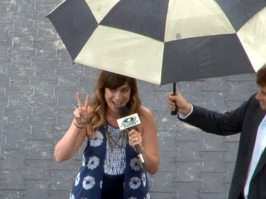 Nicole Atkins flashes a peace sign after singing God Bless America at Monmouth Park on Haskell Day 2016.