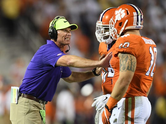 Clemson defensive coordinator Brent Venables coaches linebackers Kendall Joseph (34) and Ben Boulware (10) during the 2nd quarter at Georgia Tech's Bobby Dodd Stadium in Atlanta on Thursday.