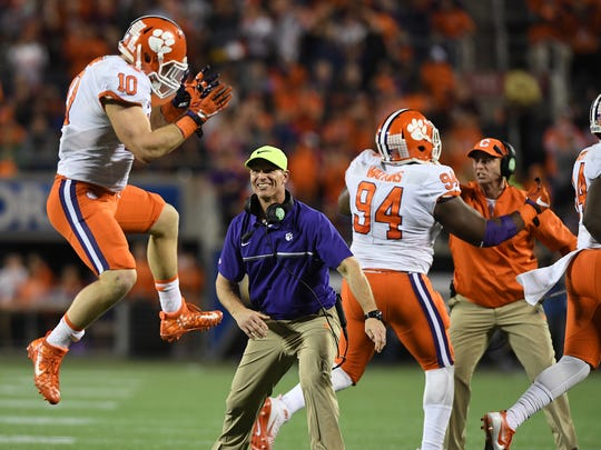 Clemson linebacker Ben Boulware (10) and defensive coordinator Brent Venables celebrates a defensive stop against Virginia Tech during the 3rd quarter of the ACC Championship at Camping World Stadium in Orlando on Saturday, December 3, 2016.