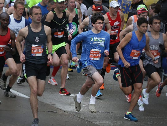 Benjamin Pachev (center) of Orem, Utah, runs the Festival