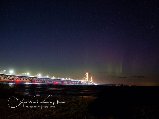 The Mackinac Bridge underneath the northern lights on July 16, 2017.