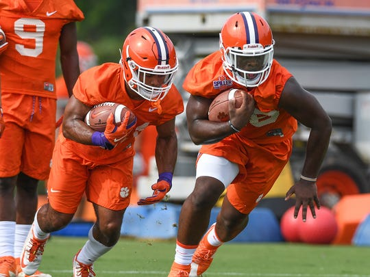 Clemson running backs Tavien Feaster (28), front, and Darien Rencher (21) during the Tigers opening day of practice on Thursday, August 3, 2017.
