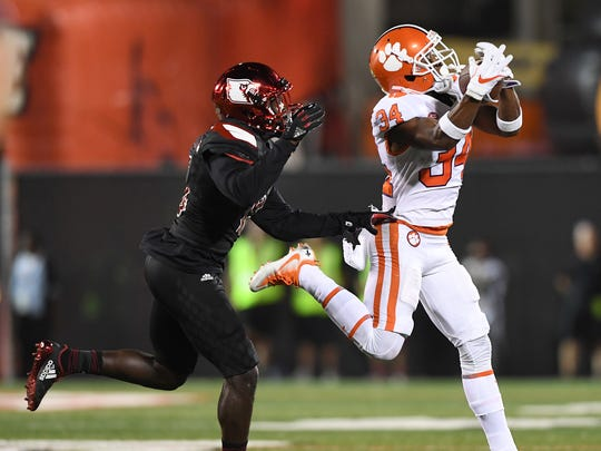Clemson wide receiver Ray-Ray McCloud (34) makes a reception against Louisville during the 2nd quarter on Saturday, September 16, 2017 at Louisville's Papa John's Cardinal Stadium.