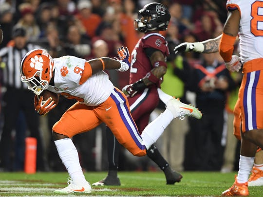 Clemson running back Travis Etienne (9) scores against