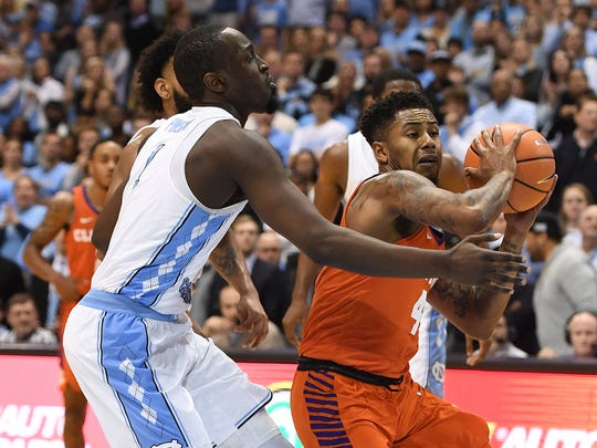 Clemson guard Shelton Mitchell (4) is guarded by North Carolina guard Theo Pinson (1) during the 2nd half on Tuesday, January 14, 2018 at UNC's Smith Center in Chapel Hill, N.C.