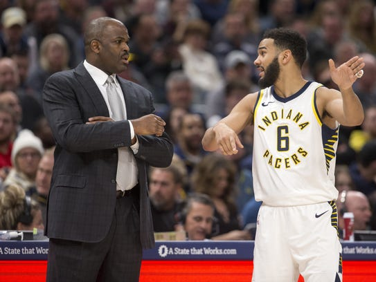 Pacers head coach Nate McMillan talks with Cory Joseph