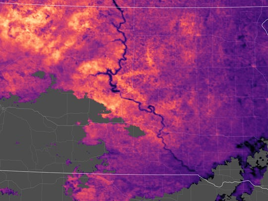 This July 5 image captures the heat signature of South Dakota, with lighter areas showing the extent of hail-cleared land across western and central South Dakota, as seen by NASA's Moderate Resolution Imaging Spectroradiometer (MODIS) aboard NASA's Terra satellite.