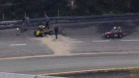 Investigators examine the scene of a fatal crash Saturday at Wall Stadium Speedway in Wall, N.J.