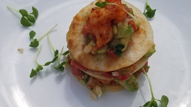 On day two of the Stuart Chopped competition, Chef Cody Harvey prepared a shrimp stack with sauteed shrimp in citrus and Manwich sauce with a splash of star fruit vinegar layered between crispy tortillas with an warm avocado salsa.