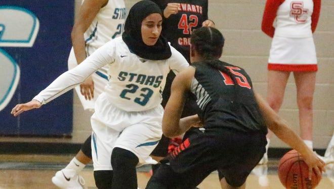 Siegel's Razan Haj-Hussein defends Stewarts Creek's Dynia Douglas during Monday's game.