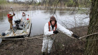 A crew takes samples on the Milwaukee River in Lincoln Park in 2013 to test the sediments for the presence of PCBs.