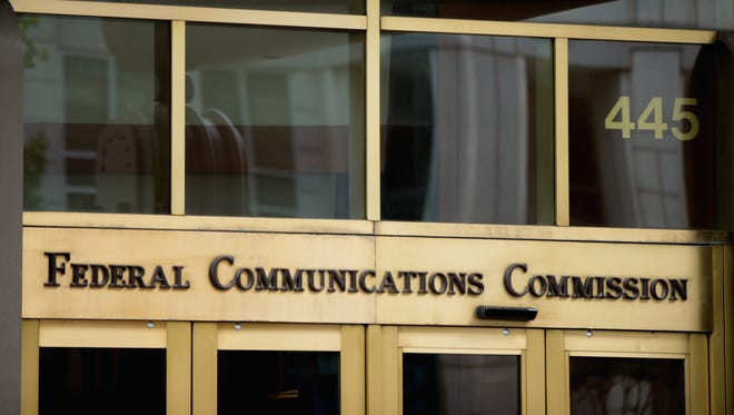 In the photo taken June 19, 2015, the entrance to the Federal Communications Commission (FCC) building in Washington.