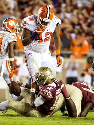 Clemson defensive lineman Christian Wilkins (42) defensive lineman Clelin Ferrell (99) celebrate after sacking Florida State Seminoles quarterback Deondre Francois (12) at Doak Campbell Stadium in the first quarter of play.