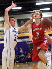 Newman Catholic's Braxton Resch drives against Amherst's Cameron Gaulke Sunday in the 44th Annual Sentry Classic Basketball Tournament in the Quandt Fieidhouse in Stevens Point..