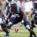 Mississippi offensive linesman Laremy Tunsil (78) steps into his blocking stance during pre-game warmups prior to an NCAA college football game against Louisiana-Lafayette at Vaught-Hemingway Stadium in Oxford, Miss., Saturday, Sept. 13, 2014. (AP Photo/Rogelio V. Solis)