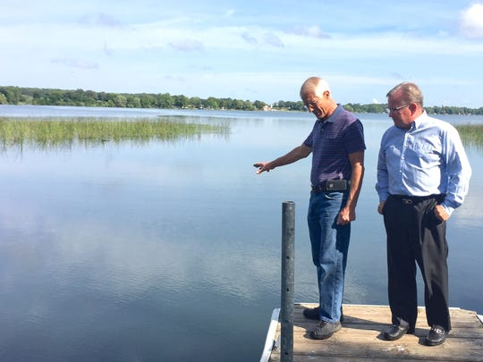 Grand Lake Area Association board members Jim Meinz, left, and Scott Palmer stand near the Grand Lake boat launch Tuesday, Aug. 15, and show where the invasive species starry stonewort was recently discovered.