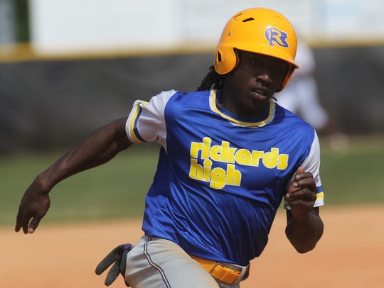 Rickards' Ferante Cowart races around third to score