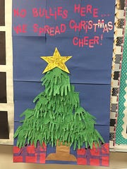 A Christmas tree made up of complimentary construction paper handprints decorates a classroom at Irion County Elementary.
