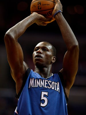 Minnesota Timberwolves center Gorgui Dieng (5), from Senegal, shoots a free throw in the first half of an NBA basketball game against the Washington Wizards, Tuesday, Dec. 16, 2014, in Washington. (AP Photo/Alex Brandon)
