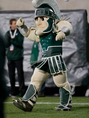Sparty, the Michigan State mascot is seen during the first half of an NCAA college football game against Ohio State in East Lansing, Mich., Saturday, Nov. 8, 2014.