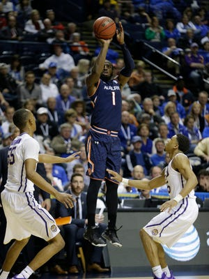 Auburn guard KT Harrell (1) shoots over LSU guard Jalyn Patterson, right, and LSU guard Tim Quarterman (55) during the second half of an NCAA college basketball game in the quarterfinal round of the Southeastern Conference tournament, Friday, March 13, 2015, in Nashville, Tenn. (AP Photo/Mark Humphrey)