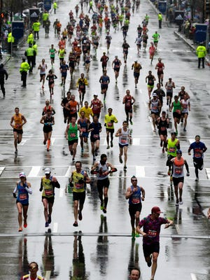 Runners approach the finish line during the Boston Marathon on Monday.