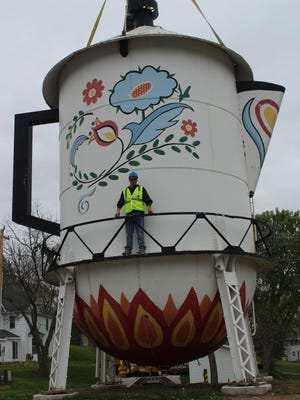 Stanton's century-old water tower painted to look like a coffeepot was cut down Thursday, April 30, and moved three blocks away to be installed as a quirky roadside museum piece on the grounds of the Stanton Historical Society.